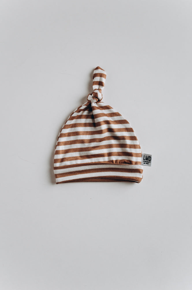 knotted baby hat in camel stripe