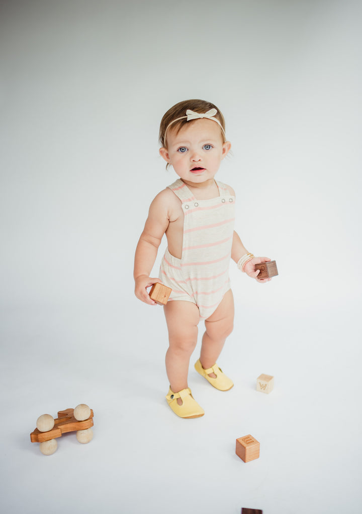 sweet orange photography of littlemissdessa baby girl in modern short romper with bannor toys