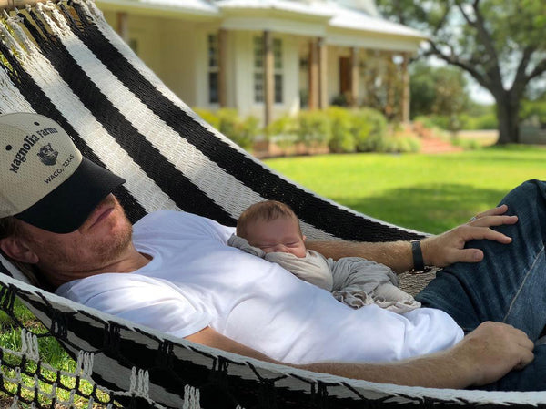 Chip Gaines with baby boy swaddled in baby blanket from LITTLEMISSDESSA