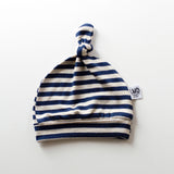 Newborn baby knotted hat in navy and oatmeal stripe pattern