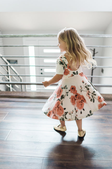 A cute little girl dancing in her jersey twirl dress