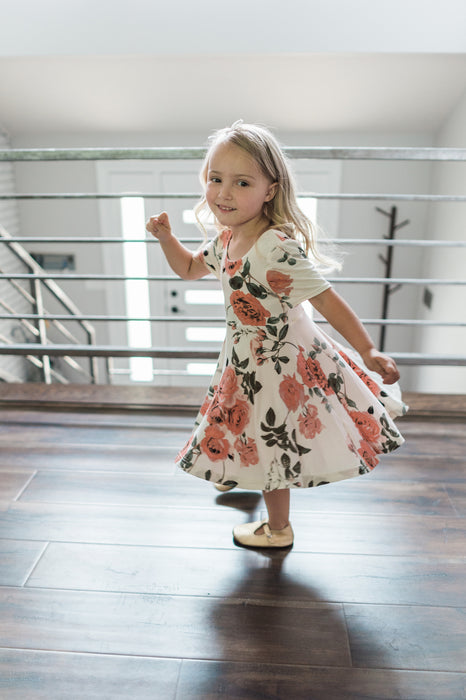 Cute little girl looking so happy in her jersey twirl dress