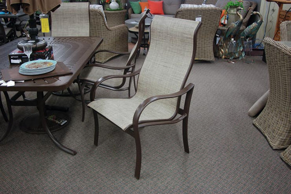 The Tropitone Shoreline High Back Dining Arm Chair is available at Jacobs Custom Living Spokane Valley WA showroom.