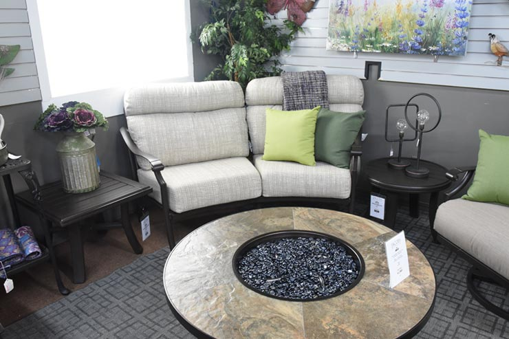 Tropitone's Montreux II Cushion Crescent Love Seat is available at Jacobs Custom Living in Spokane Valley WA.