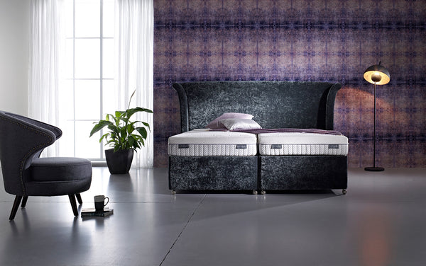 Purple bedroom wallpaper from Blackpop sets off this tempting Dunlopillo Firmrest bed