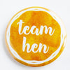 Team Hen Juicy Sunburst Badge Design