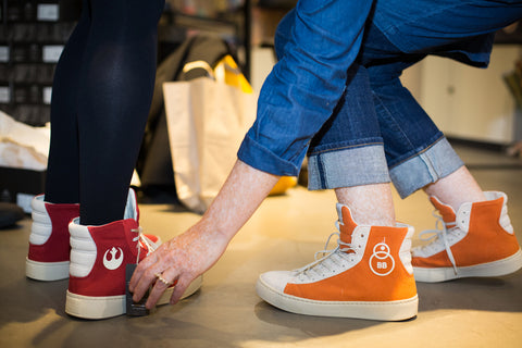 Helen Taylor and Ali Clifford trying sneakers at Po-Zu event