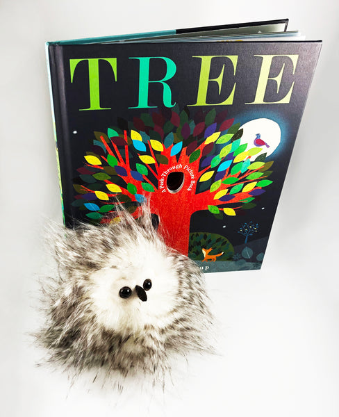 Tree, Britta Teckentrup peek through book with Bertie Owlet stuffy