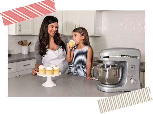 Mom and daughter baking cupcakes with stand mixer