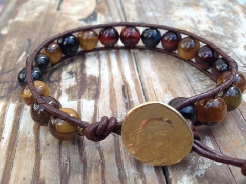Tiger Eye leather wrap bracelet accented with gold Greek coin.