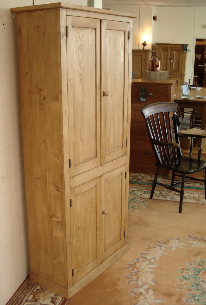Four door honey pine housekeepers cupboard.