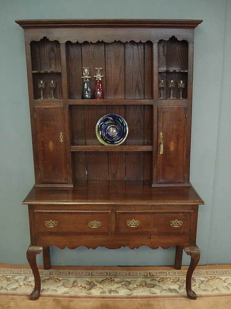 C19th oak dresser of smaller proportions. With spice cupboards and mahogany inlay.
