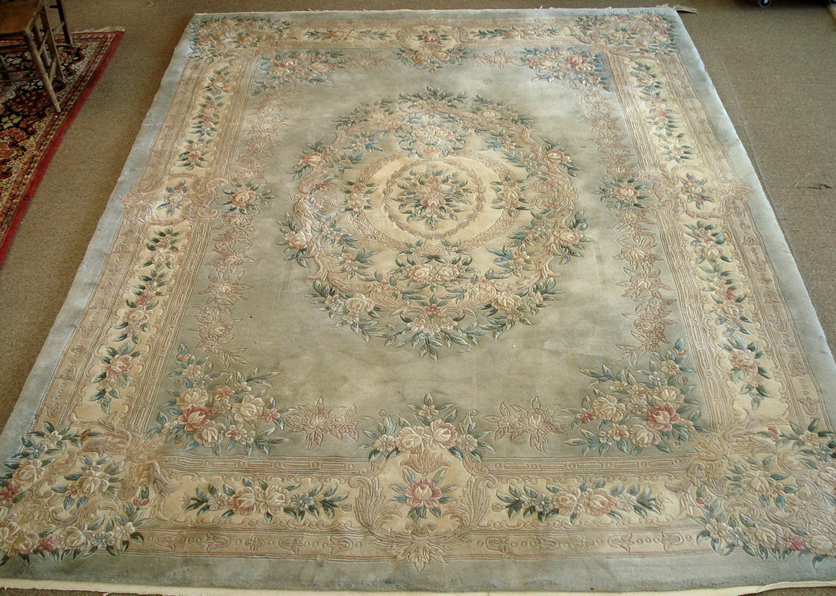 Rug 12ft by 9ft. No fringing.