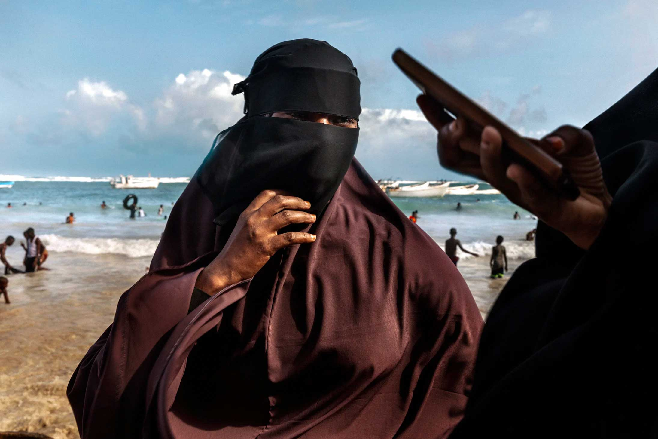 Today, women, surfers and the youth of pack Lido Beach in Mogadishu - © MARCO GUALAZZINI