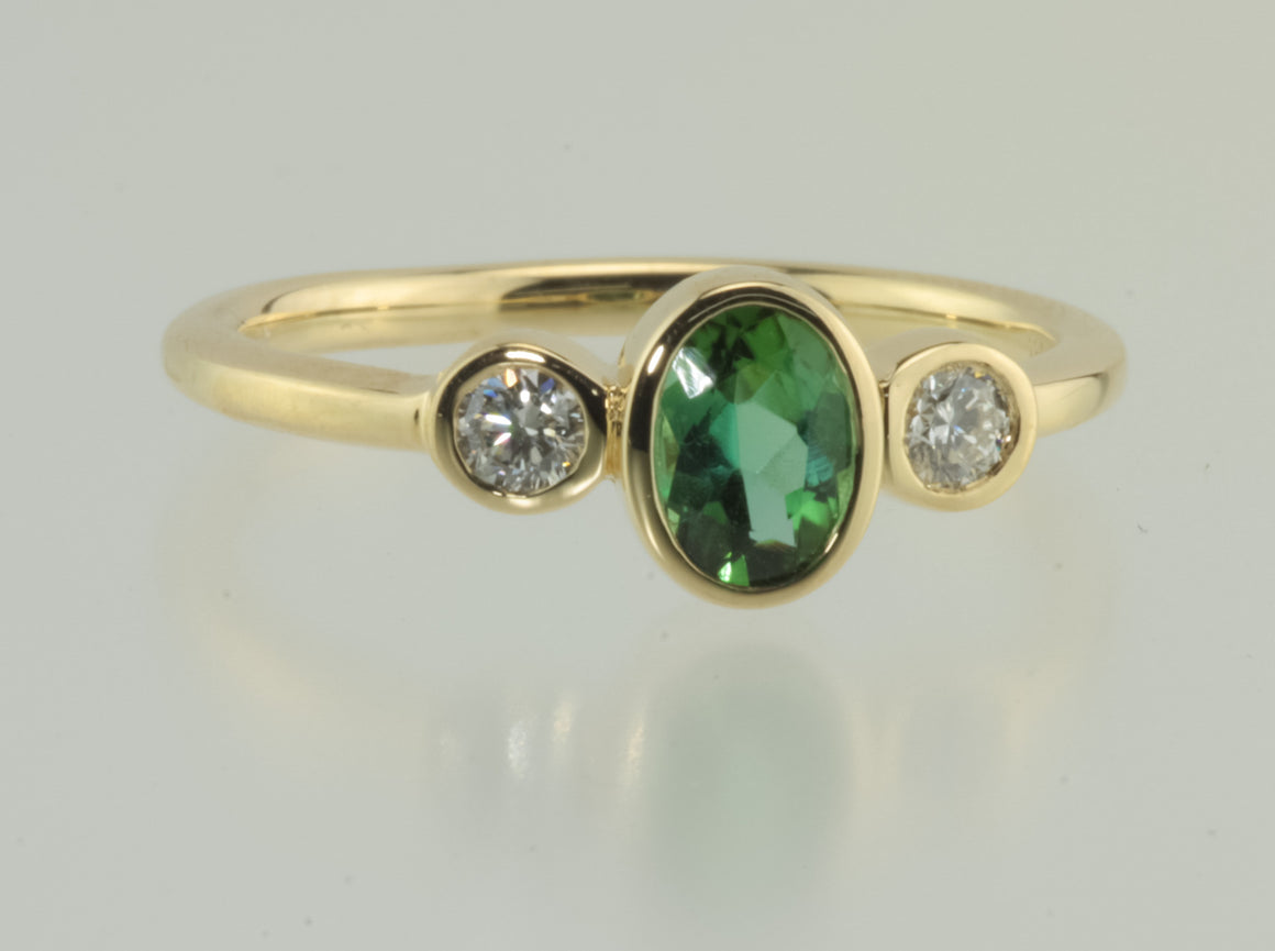 Green Tourmaline and Diamond Bezel Set 18kt Yellow gold ring