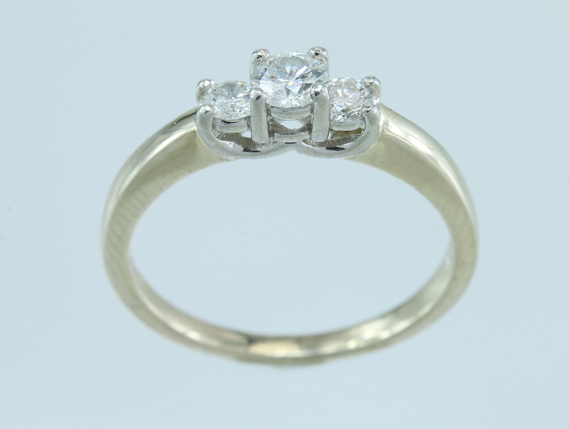 1/3ctw Diamond Three Stone 14kt and Platinum Rind