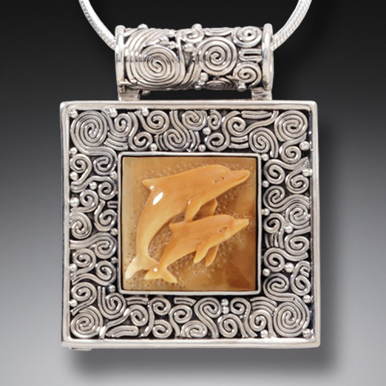 """Dolphin Play"" Fossilized Walrus Tusk and Sterling Silver Locket"
