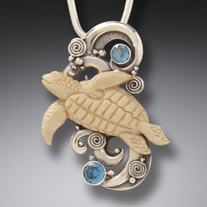 """Turtle Spirit"" Fossilized Mammoth Tusk, Blue Topaz, and Sterling Silver Pendant"