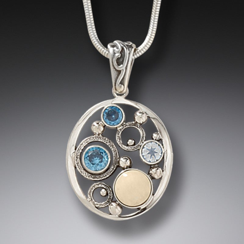 """Arctic Dreams"" Ancient Fossilized Mammoth Ivory Tusk, Blue Topaz and Rainbow Moonstone Silver Pendant"