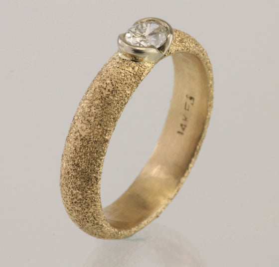 Oval Diamond In 14kt Partial Bezel Ring