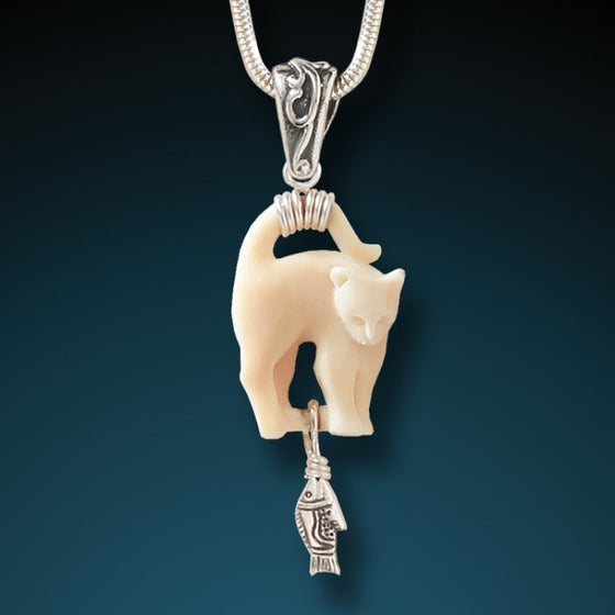 """Cat's Meow"" Fossilized Mammoth Ivory and Sterling Silver Pendant"