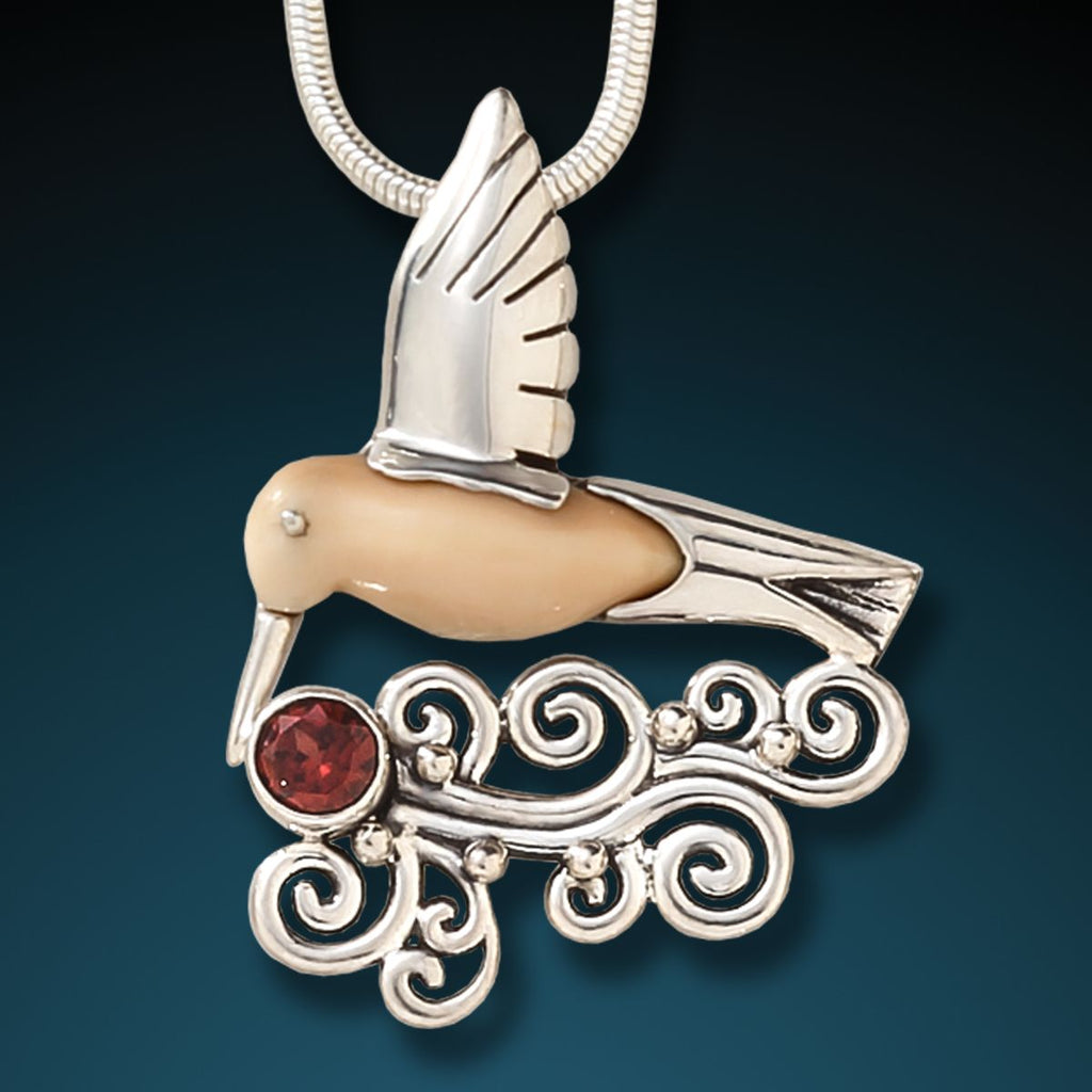 FOSSILIZED WALRUS IVORY, SILVER, GARNET HUMMINGBIRD PENDANT - HEART SONG HUMMINGBIRD