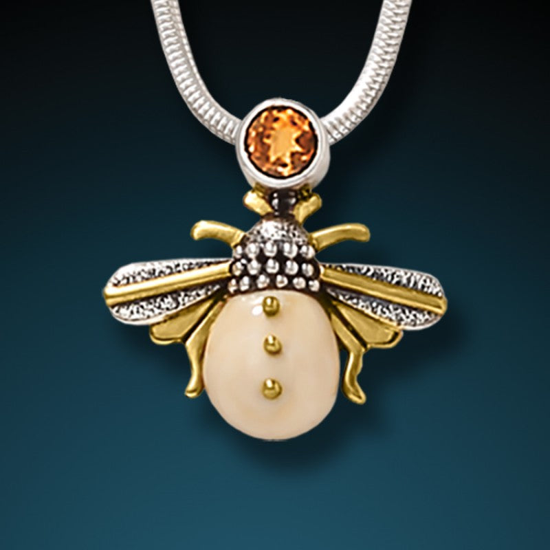 """Honeybee"" Fossilized Walrus Tusk Citrine and Sterling Silver Pendant"