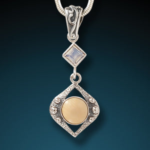"""Night Rain"" Fossilized Walrus Tusk and Moonstone Sterling Silver Pendant"