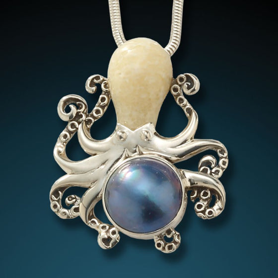 """OCTOPUS WITH MABE""  FOSSILIZED WALRUS IVORY OCTOPUS WITH MABE PEARL"