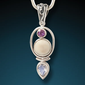 """Finding Balance"" Fossilized Mammoth Ivory, Amethyst, Moonstone and Sterling Silver Pendant"