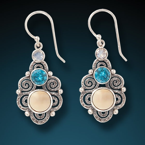 """Stardust"" Fossilized Walrus Tusk, Blue Topaz, and Moonstone and Sterling Silver Earrings"