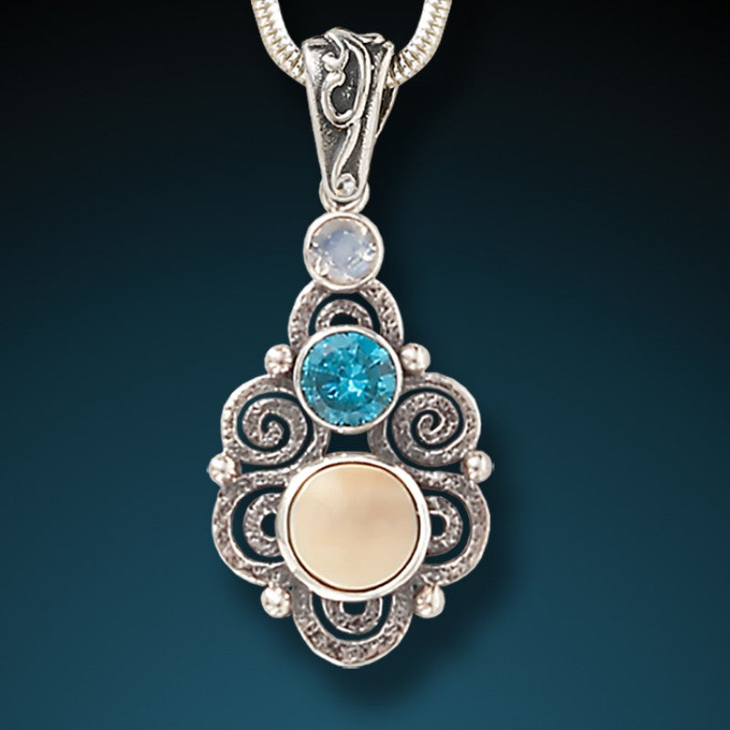 """Stardust"" Fossilized Walrus Tusk, Blue Topaz, and Moonstone and Sterling Silver Pendant"