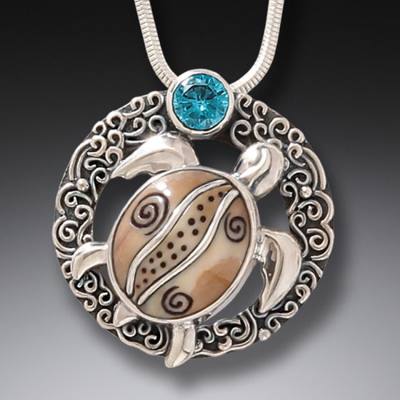 """Ocean Dreams"" Fossilized Mammoth Tusk, Blue Topaz and Sterling Silver Pendant"