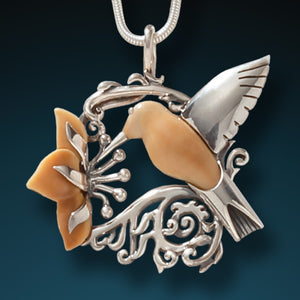 FOSSILIZED WALRUS IVORY AND SILVER HUMMINGBIRD PENDANT – HUMMINGBIRD SPRING