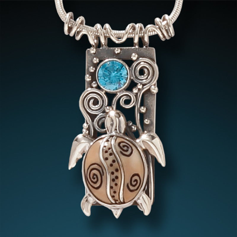 FOSSILIZED WALRUS IVORY, TOPAZ AND SILVER TURTLE PENDANT – WATER SEEKER