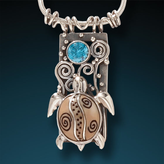 """Water Seeker"" Fossilized Mammoth Tusk, Blue Topaz and Sterling Silver Pendant"
