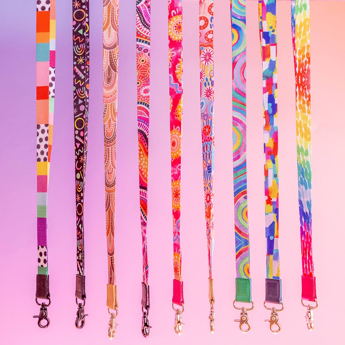 Colourful lanyards all in a line against a purple gradient background