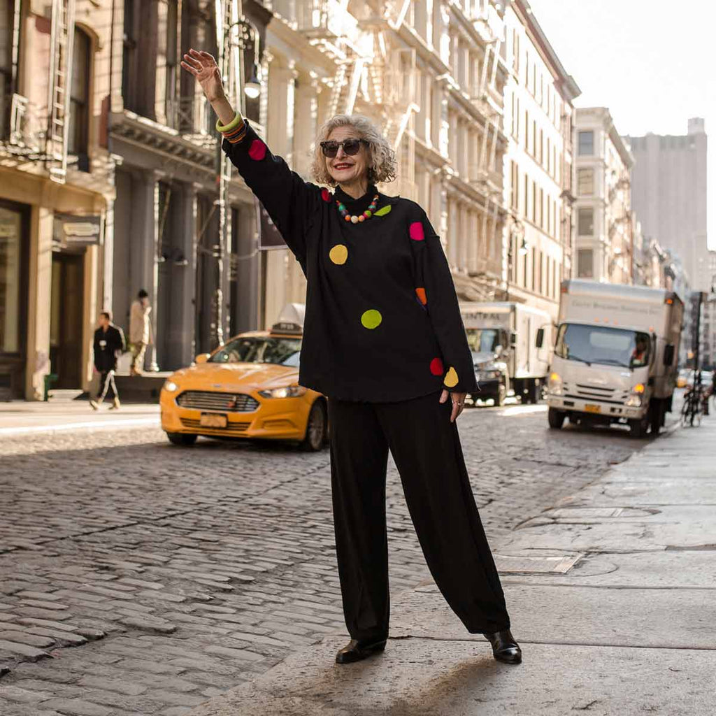 Dayle from Artful City Style Hailing a Cab in New York City wearing colorful Ruby Olive Jewelry