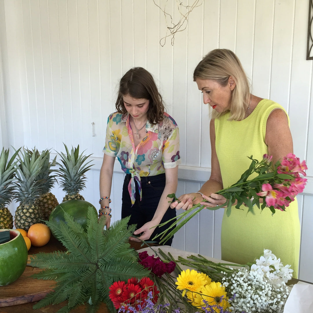 Michaela and Genevieve Prepping the Flowers for the Arrangement