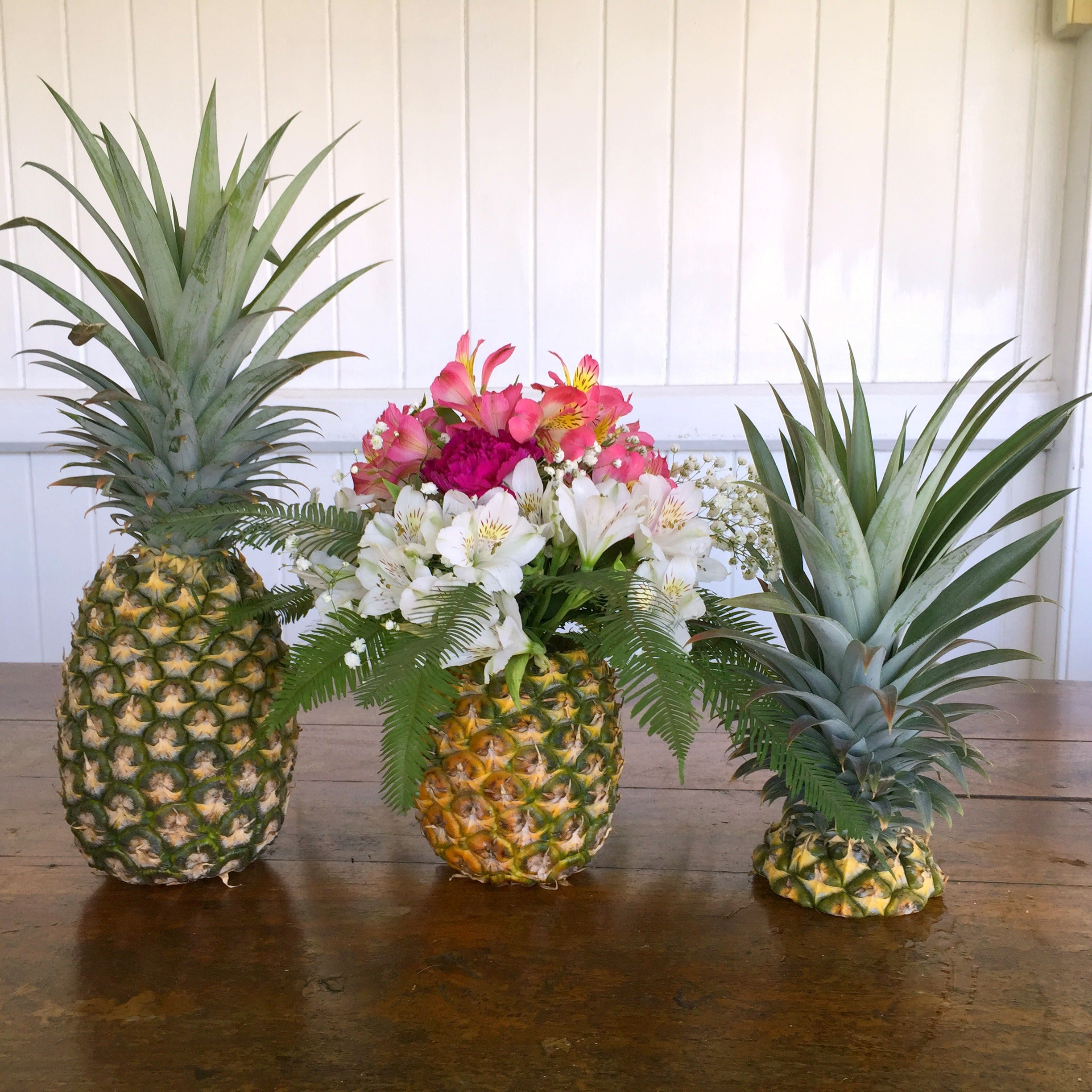 Watermelon Table Setting with three Pineapples