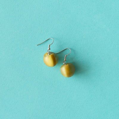 Ruby Olive Jewellery mustard seed pod drop earrings on blue background