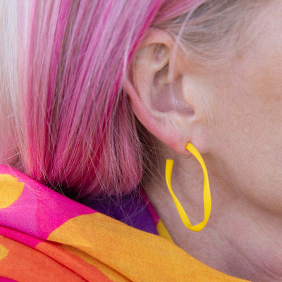 RO20-MEGANS-PHOTOSHOOT-MEGAN-YELLOW-HOOP-CLOSE-UP.jpg
