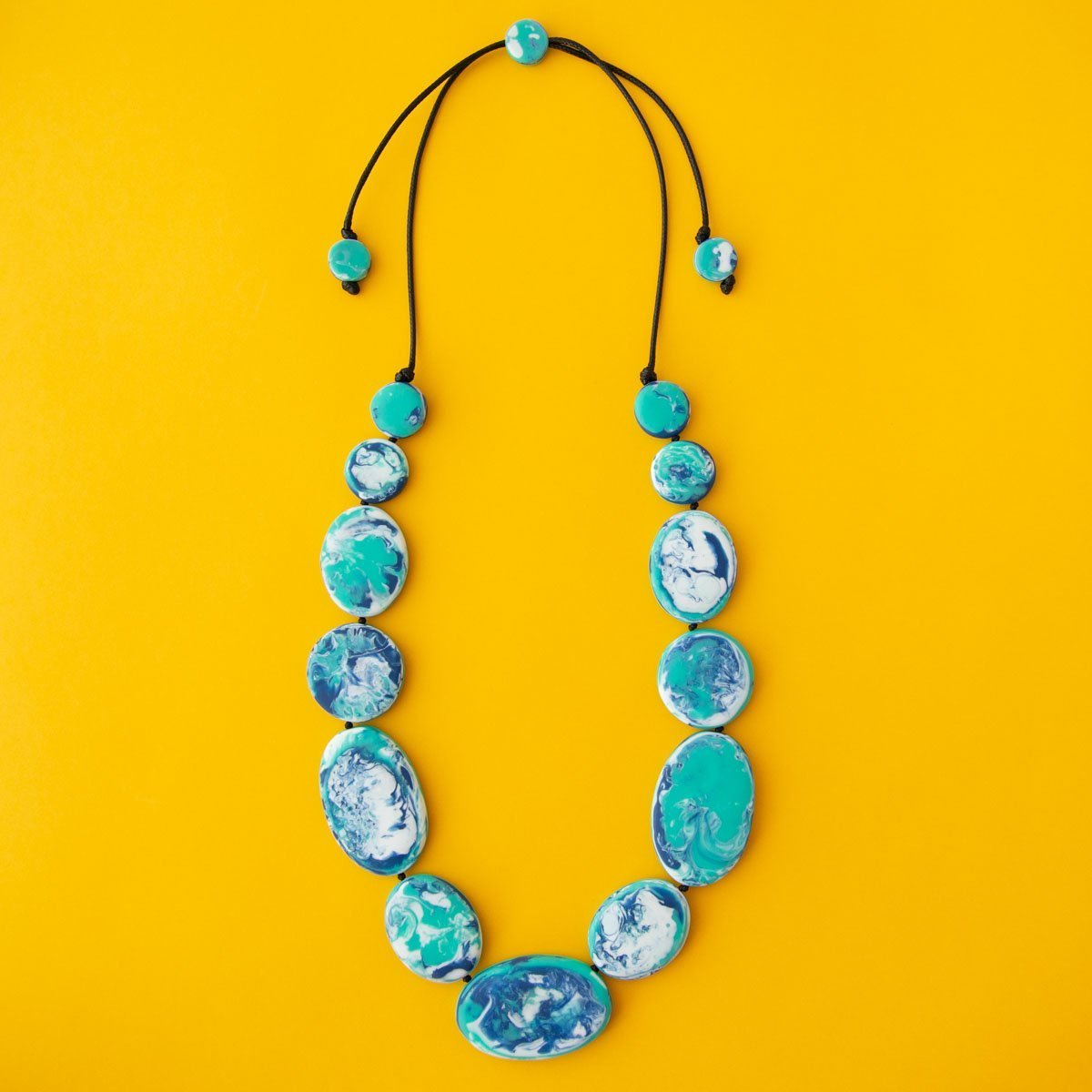 RO2080NK-AQUABLUE-SEAFOAM-NECKLACE-YELLOW-BACKGROUND.jpg