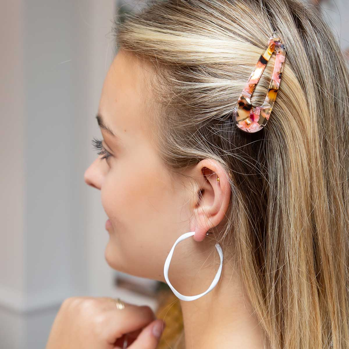 model-wearing-tallulah-tortie-hair-clip-and-white-hoop-earrings.jpg