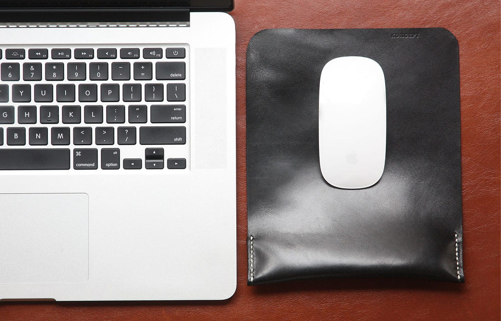 black mouse pad next to macbook pro