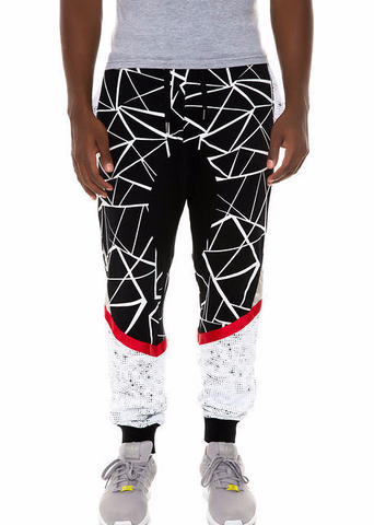 The S.Q.Z. French Terry Cut Block Geometric Printed Drop Crotch Jogger with Red Point Tape in Black