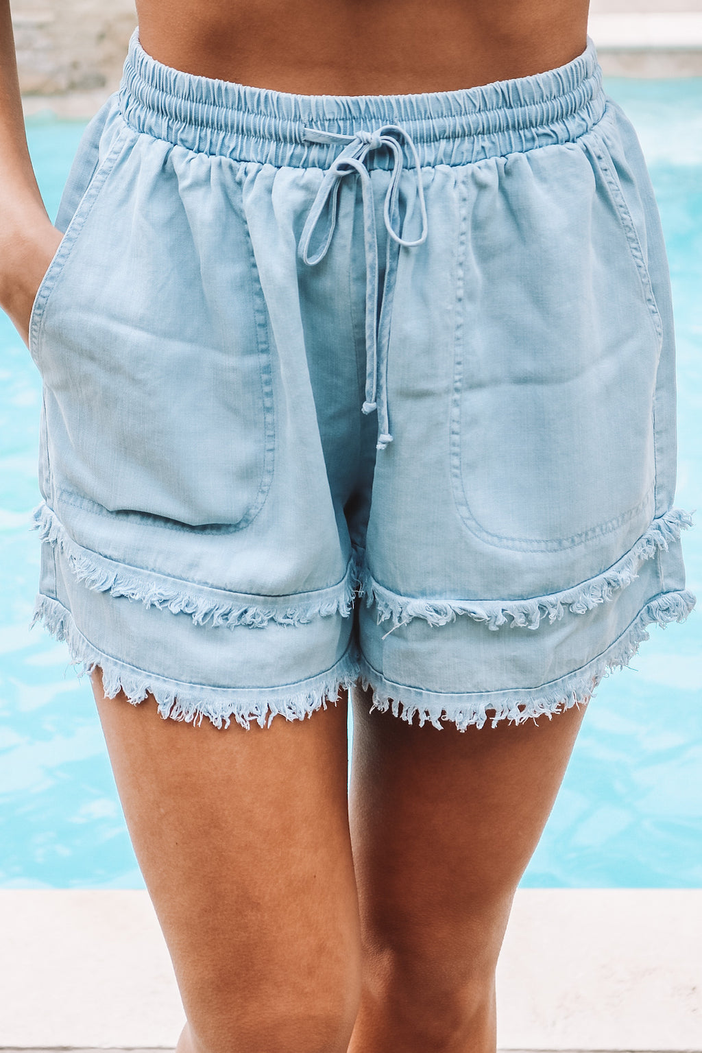 Washed Denim Tiered Fringe Shorts