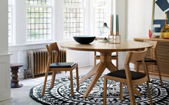 Cross round dining table