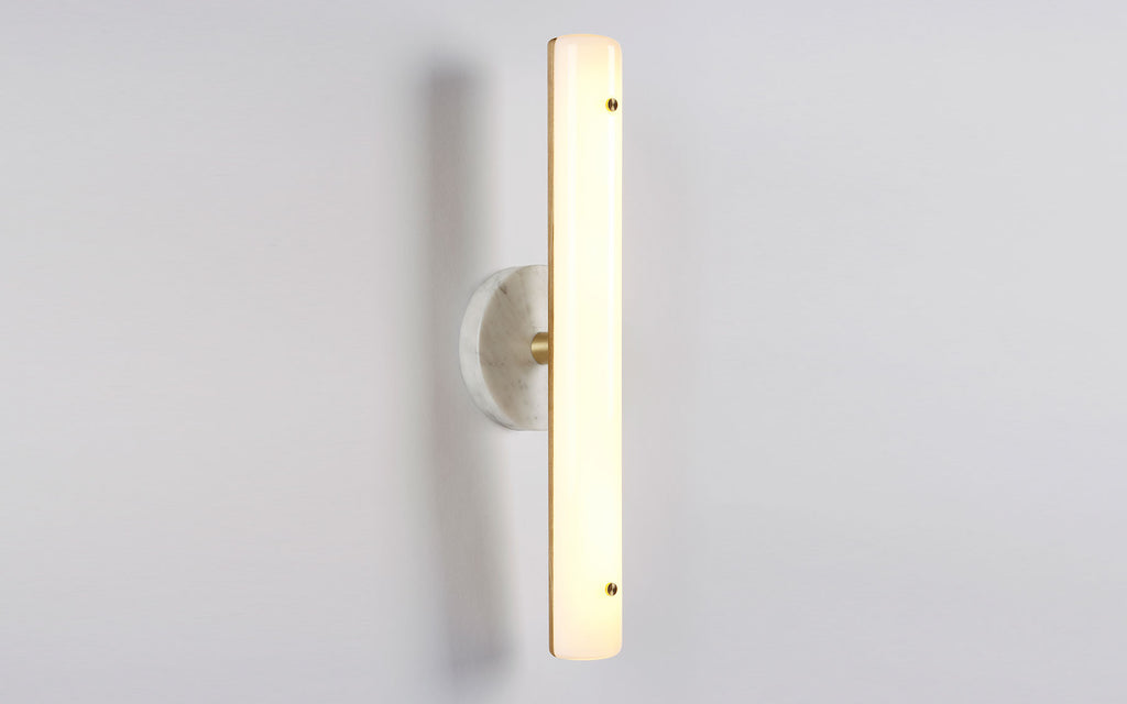 Counterweight circular wall sconce