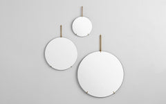 Round wall mirrors with brass fittings